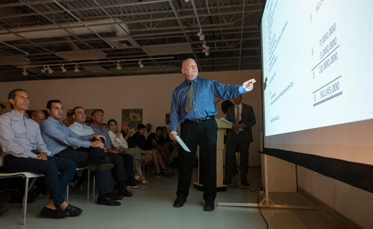 Mark Gerber, Birmingham finance director and treasurer, goes over numbers during a July 16 community meeting about a new proposed parking structure for which the city is seeking approval of a $57.4 million bond.