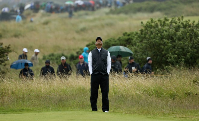 Tiger Woods looks skyward as he wait to play on the 17th green during the second round Friday.