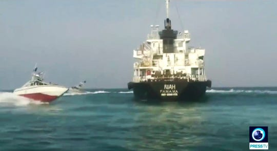 The Panamanian-flagged oil tanker MT Riah surrounded by Iranian Revolutionary Guard vessels.
