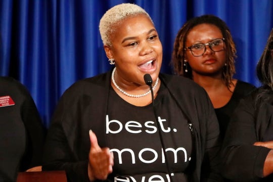 "FILE - In this May 7, 2019 file photo Rep. Erica Thomas, D-Austell, speaks during a news conference in Atlanta. Thomas says she was verbally attacked in a supermarket by a white man who told her, ""Go back where you came from."""