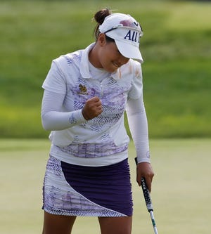 Jasmine Suwannapura reacts after her birdie putt on the 18th green during the third round of the Dow Great Lakes Bay Invitational on Friday.