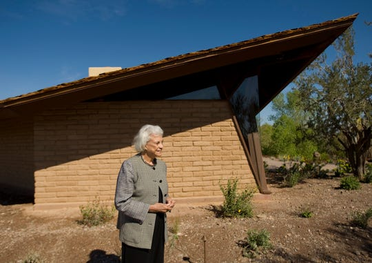 FILE - In this March 1, 2010 file photo,  retired Supreme Court Justice Sandra Day O'Connor stands in front of her 1958 adobe home that was moved and restored at the Arizona Historical Society Museum in Tempe, Ariz.