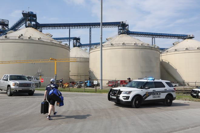 Toledo Fire and Rescue personnel on the scene where two workers died after they were trapped in a silo filled with grain.