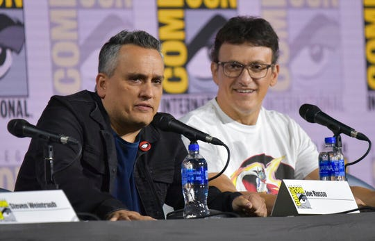 Joe Russo, left, and Anthony Russo participate in a conversation with the Russo Brothers on day two of Comic-Con International on Friday, July 19, 2019, in San Diego.