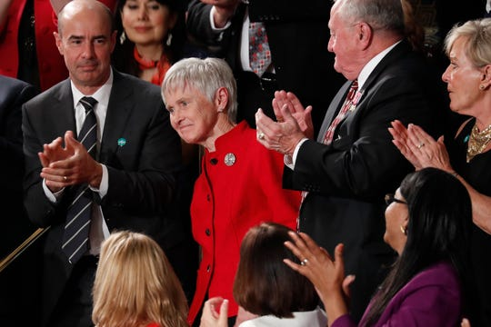 FILE - In this Feb. 28, 2017, file photo, Maureen McCarthy Scalia, widow of Supreme Court Justice Antonin Scalia, is recognized by President Donald Trump as her son Eugene Scalia, top left, applauds, during his address to a joint session of Congress on Capitol Hill in Washington.