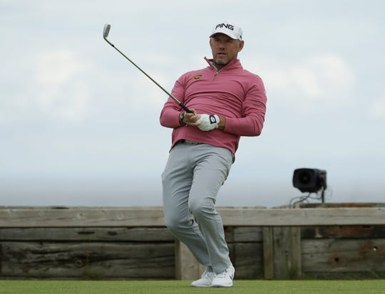 Lee Westwood reacts to his tee shot on the sixth hole during the second round of the British Open.