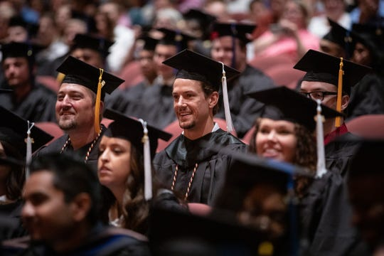 Danny DeKeyser sits among fellow Western Michigan graduates.