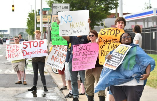 People protest in front of the ICE Detroit Field Office in Detroit Friday evening after  five Iraqis allegedly were detained and held for deportation.
