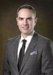 Elmira native John Ford is a partner at O'Brien and Ford, a law firm in Buffalo.