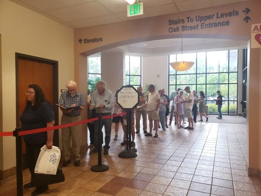 Larimer County residents line up July 15 to file paperwork requesting hearings with the County Board of Equalization on their assessed property values.