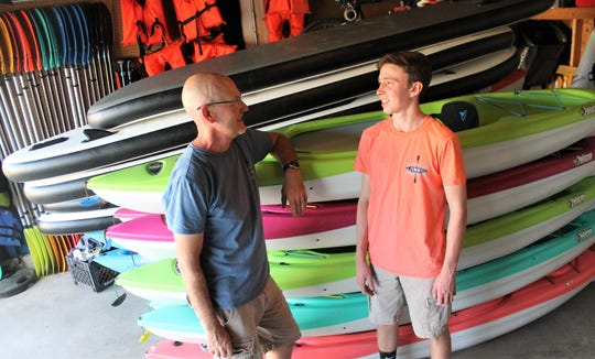 Eric Harding, left, and his son, Jackson Harding, work together to run Harding Kayak Rentals from their Fort Collins home.