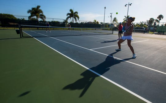 Cape Coral resident Alexandria Dahms returns the ball during a friendly tennis match Thursday morning, July 18, 2019. The city of Cape Coral is considering proposal to build a restroom and office facility on the site of the five tennis courts at the Cape Coral Yacht and Racquet Club. Opponents say that it is too difficult to get to the nearest site, Kennedy Park and note that the courts get steady use throughout the day.