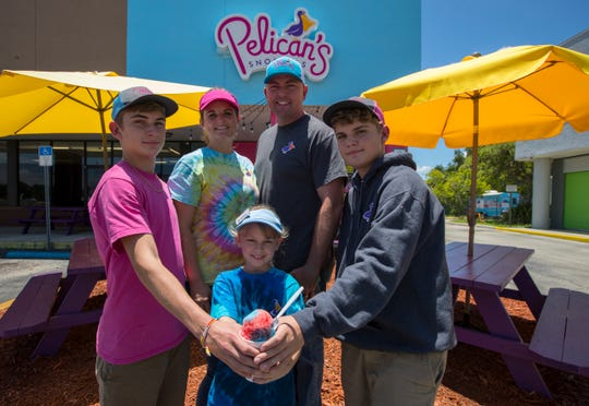 Trina and Paul Everhart are the owners of Pelican's SnoBalls in North Fort Myers. Their kids joined them for the photo: from left, Carter, 13, Aubrey, 7, and Blake, 12.