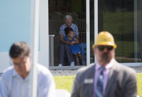 Hazel Gambleton, 3, is held by Carole Angilletta  at a ground breaking ceremony for the expansion of the Lifeline Family Center in Cape Coral on Thursday July, 16, 2019.