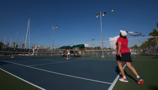 Cape Coral resident Marion Kminek serves the ball during a friendly tennis match Thursday morning, July 18, 2019. The city of Cape Coral is considering proposal to build a restroom and office facility on the site of the five tennis courts at the Cape Coral Yacht and Racquet Club. Opponents say that it is too difficult to get to the nearest site, Kennedy Park and note that the courts get steady use throughout the day.