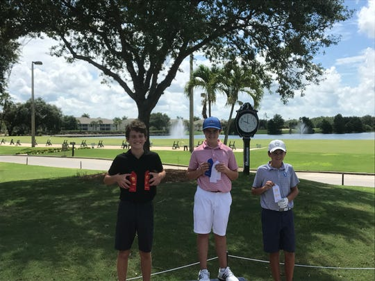 Aidan MacInnes (left) of Bonita Springs and Braden Miller (right) of Naples took second and third place of the boys' 12-13 year-old division of Saturday's Drive, Chip and Putt event at Stoneybrook Golf Club.