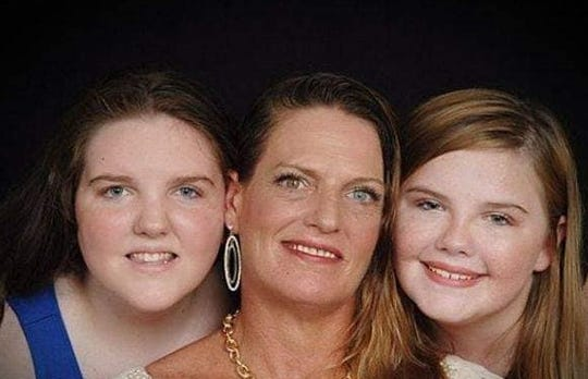 Juliane Kellner,  the victim in a murder-suicide in Henderson, Nevada, shown with her twin daughters, Faith and Hope.