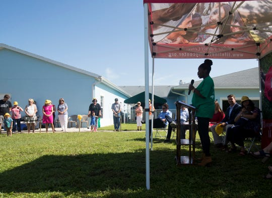 Emilienne Joseph, a resident of  Lifeline Family Center speaks at a ground breaking ceremony for the expansion of the Lifeline Family Center in Cape Coral on Thursday July, 16, 2019.