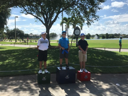 Cape Coral's Adrian Banham (center) won the boys' 10-11 year-old division at Saturday's Drive, Chip and Putt event at Stoneybrook Golf Club. Braden Grable (left) of Cape Coral finished second.