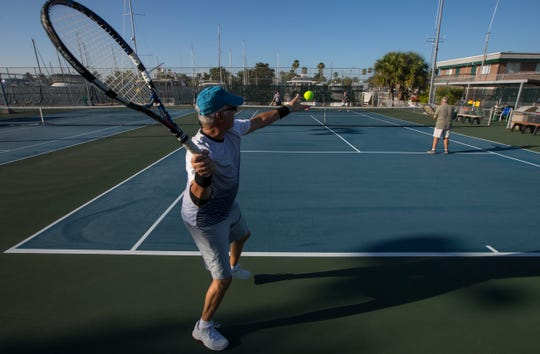 Cape Coral resident Steven Averbach serves the ball during a friendly tennis match Thursday morning, July 18, 2019. The city of Cape Coral is considering proposal to build a restroom and office facility on the site of the five tennis courts at the Cape Coral Yacht and Racquet Club. Opponents say that it is too difficult to get to the nearest site, Kennedy Park and note that the courts get steady use throughout the day.