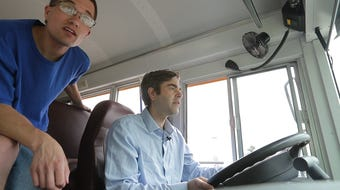 Reporter Jeff Bollier tries his hand at driving a school bus at Lamers.