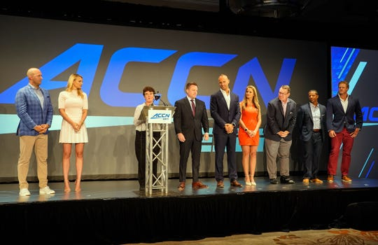 The fledgling ACC Network introduced its Game day talent for the upcoming football season -- from left, Matt Hasselbeck, Katie George , Chris Cotter, Mark Herzlich, Kelsey Riggs, Wes Durham, Roddy Jones, and Eric Wood --during the 2019 ACC Kickoff in Charlotte.