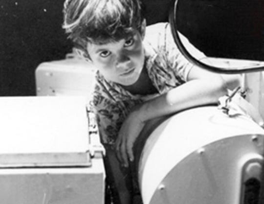 A photo of a 10-year-old Greg Force on the night of July 23, 1969, when  he successfully greased a bearing in a NASA satellite that helped maintain communication for the Apollo 11 astronauts. Force is now the owner of a Greenville gymnastics studio. The photo was taken by a NASA employee.