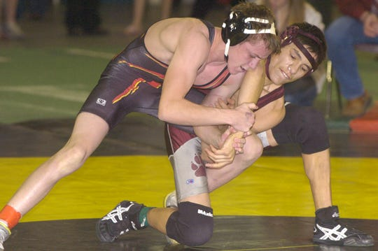 Ryan Leonard of Simms, left, was a four-time state wrestling championship in high school.