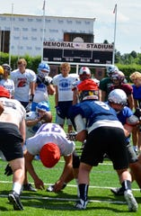 Fairfield's Ryder Meyer (kneeling, left) takes the snap as Shelby's Wyatt Brusven (right, red jersey) prepares to practice booting a PAT at Thursday's East All-Star team practice for the 73rd Montana East-West  Shrine Football Game Saturday night in Butte.