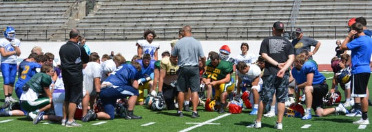 Fairfield coach Les Meyer (center, back to camera) addresses the East All-Stars on their final day of practice Thursday at Memorial Stadium before the team leaves for Butte Friday morning.