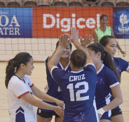 The Guam women's volleyball team savor a win over the Solomon Islands 3-1 July 19 at the Pacific Games at the National University of Samoa.
