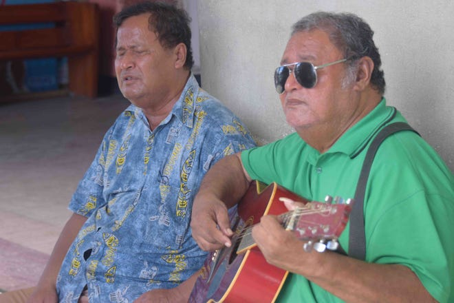 On a dusty, shaded sidewalk, two Samoan brothers sing from the soul.