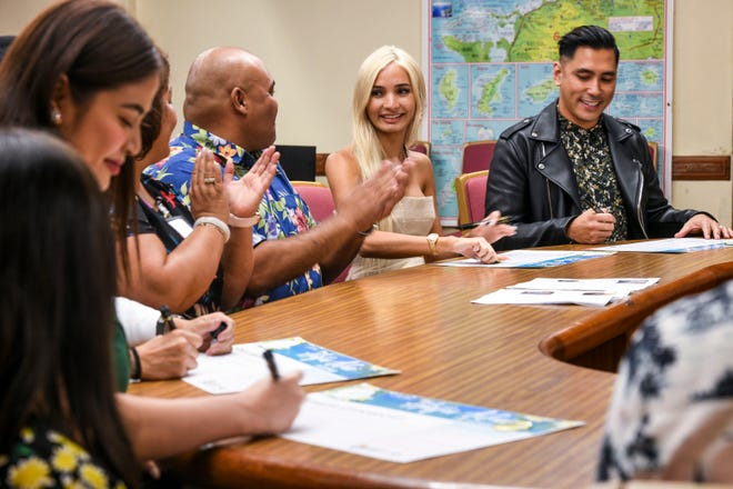 Guamanian singer, songwriter, and model Pia Mia Perez, center, and other guest personalities are applauded after signing Hafa Adai pledges during a press conference at Adelup on Friday, July 19, 2019. During the conference Perez, Rose Laguana, David Cruz, and Valerie Concepcion were introduced to be amongst the Liberation Day Parade guests.