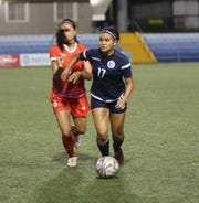 Lauren Phillips, No. 17, called up to Guam's U19 Women's team, looks for options in the midfield during a recent friendly match against Hualien FC from Chinese Taipei.