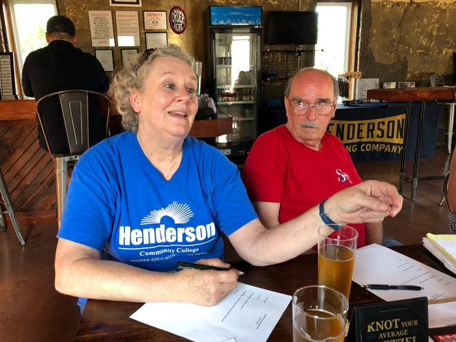 Leslie Hoskins makes a remark at Henderson Brewing Co. during a planning session for the Sandy Lee Watkins Songwriters Festival earlier this month. Hoskins won tickets to a Songfest show several years ago and has been involved (along with her husband, Steve, at right) in helping organize the event ever since.