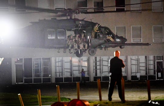 Troops are lifted off from the parking lot of the old IBT church building on Second Street in Henderson after a training exercise Thursday night complete with flash-bang grenades and fake gunfire.