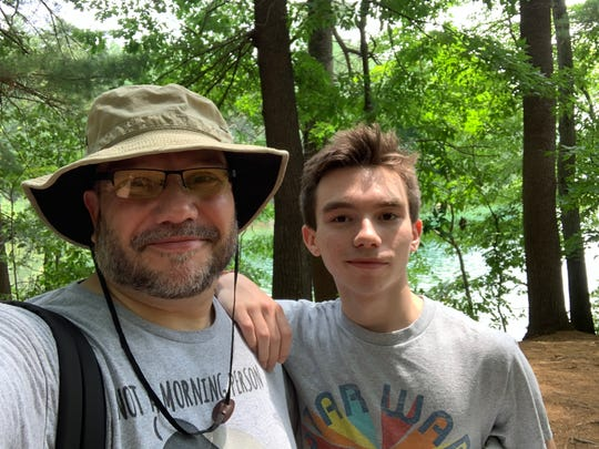 Josh and Harrison Jenkins stop for a selfie near the site where American essayist, poet, and philosopher Henry David Thoreau's cabin once stood at Walden Pond.