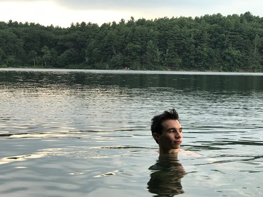 Beyond the public beaches, there are areas at Walden Pond where visitors can find more serenity and solitude as they wade into the waters, as Harrison Jenkins does here.