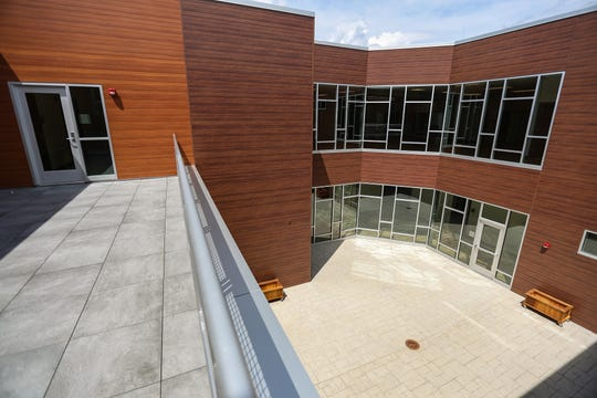 A balcony overlooks the courtyard at the newly built Southeastern Elementary School in Fishers, Ind., on Thursday, July 18, 2019.