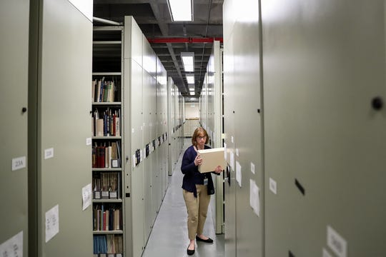 Suzanne Hahn, vice president of archives and library for the Indiana Historical Society, pulls a box of documents from the society's archives.