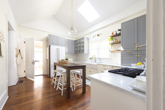 The redesigned and modernized kitchen features stone countertops that catch the light of the skylight that was added to bring in more light to the room. This home, built in 1870, is situated in the heart of Johnson County's county seat, Franklin, Thursday, July 18, 2019.