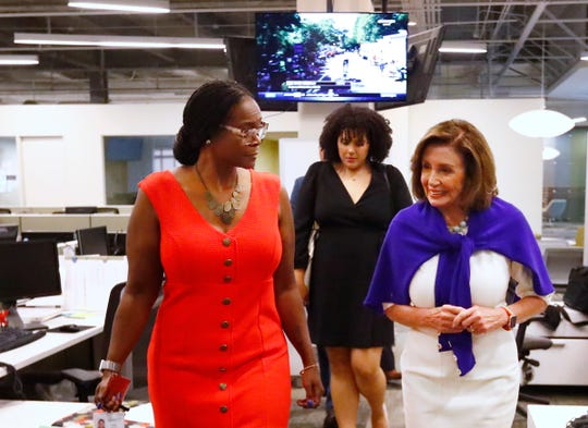 Speaker of the House Nancy Pelosi arrives to speak with the IndyStar editorial board, while in Indianapolis for the Young Democrats of America's annual convention, Friday, July 19, 2019.  IndyStar Director of Opinion & Community Engagement Suzette Hackney, left, takes her into the meeting.