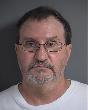 Alan Dale Rieken, 54, was arrested after police say he made threats to shoot people while he displayed a gun on July 18, 2019 in North Liberty.