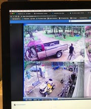 This photo of a computer screen shows surveillance video posted on Facebook of a man spotting an approaching tornado in Marshall County, Miss.