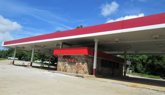 Long an eyesore, this deserted Phillips 66 station could be changing into a vibrant addition to the Mixed Use Town Center district called Admirals Landing.