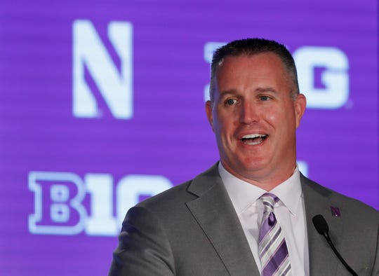 Northwestern head coach Pat Fitzgerald responds to a question during the Big Ten Conference NCAA college football media days Friday, July 19, 2019, in Chicago. (AP Photo/Charles Rex Arbogast)