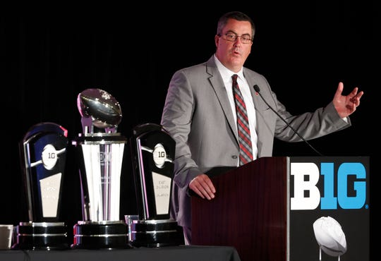 Wisconsin head coach Paul Chryst responds to a question during the Big Ten Conference NCAA college football media days Friday, July 19, 2019, in Chicago. (AP Photo/Charles Rex Arbogast)