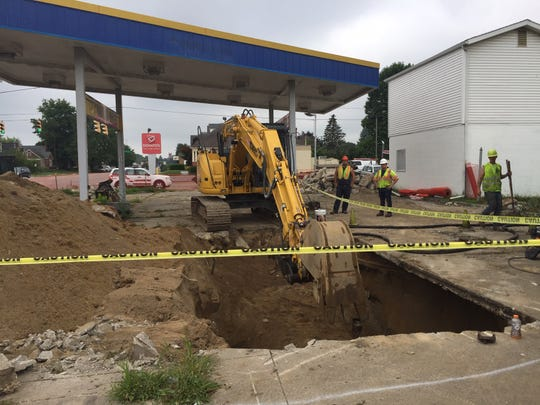 Workers from U.S.T. Environmental, Inc., prepare to removed three gas tanks under the abandoned Workingman Friend's gas station at 845 E. Main St. The Fairfield County Land Bank plans to clean up the property for reuse.