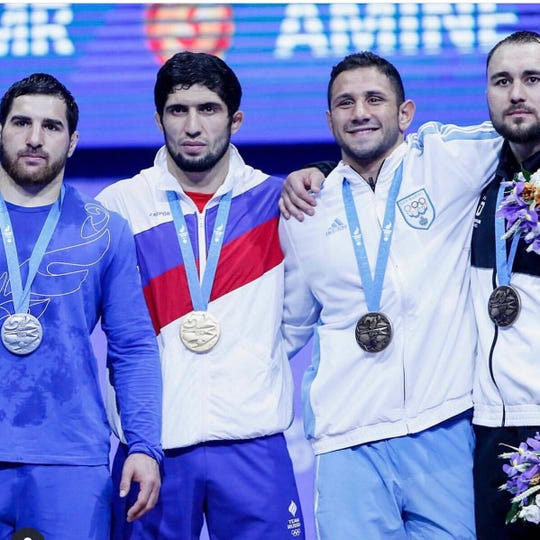 Myles Amine (second from right) of Brighton won a freestyle wrestling bronze medal in the European Games in Belarus.