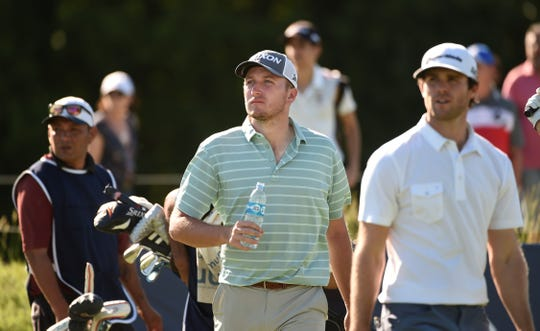Pinckney graduate Otto Black (center) has played in 11 countries during his two years on the PGA Tour Latinoamerica.